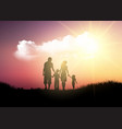 silhouette of a family walking against a sunset vector image vector image