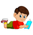 boy reading story book vector image vector image