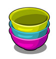 a stack of polymer bowls of different colors vector image vector image