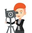 Cameraman with movie camera on tripod vector image vector image