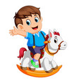 cute boy on a toy horse vector image