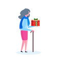 senior woman with stick holding gift box happy new vector image vector image