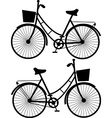 Vintage bicycles black silhouetteon a white vector image vector image