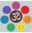Chakra pictograms and symbol OM in the centre vector image