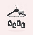 cute hanging sale tags on clothing hanger on pink vector image vector image