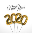 new year 2020 celebration with gold foil balloons vector image