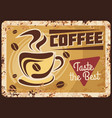 steaming coffee cup with steam beans rusty plate vector image vector image