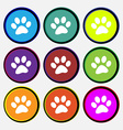 paw icon sign Nine multi colored round buttons vector image vector image