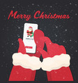 santa hands using smartphone online mobile app vector image vector image