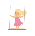 lovely blonde girl swinging on a rope swing vector image vector image