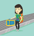 woman picking up suitcase on luggage conveyor belt vector image vector image