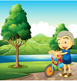 A cute little boy playing with his bike vector image vector image