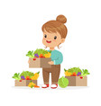 cute little girl holding basket with vegetables vector image