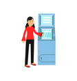 young smiling woman standing near cash machine vector image