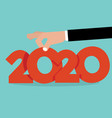 hand pick up 2020 vector image vector image