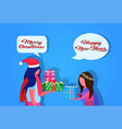 african american mother daughter giving gift box vector image vector image