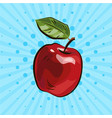 dark red apple with green leaf on blue background vector image vector image