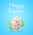 easter egg and blue spring flowers vector image vector image