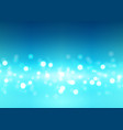 abstract bokeh lights on blue background vector image vector image