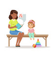 teacher reading a book to little girl sitting on a vector image vector image