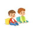 two sweet smiling little boys sitting on the floor vector image vector image