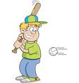 Cartoon boy hitting a baseball vector image vector image