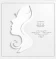 Profile of a beautiful woman cut out of paper vector image vector image