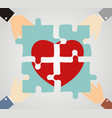 hands putting heart puzzle pieces together vector image vector image