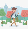 young businessman with coffee walking in park vector image