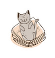 cute naughty cat lying on pile of clothes and vector image