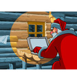 Santa Claus typing a letter on the computer vector image vector image
