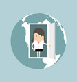 businesswoman opens door from the globe vector image
