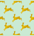 golden easter seamless pattern with rabbits vector image vector image