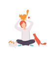 man sitting on the floor surrounded by cats vector image vector image