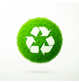 Recycle symbol on a green grass vector image