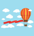 classic hot air balloon with red ribbon flying vector image