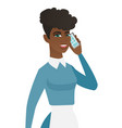 young african cleaner talking on a mobile phone vector image vector image