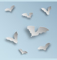 flock of bats in paper art style on a light blue vector image vector image