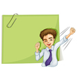 A happy businessman in front of an empty signage vector image vector image