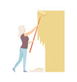 woman paints the wall with roller flat vector image vector image