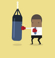 african businessman punching punch bag vector image