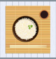 rice in bowl with chopsticks kitchen bamboo mat vector image