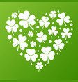 white grunge heart made of small shamrock vector image