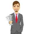 business man winner holding a silver cup trophy vector image vector image
