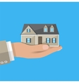 Businessman hand holding house real estate vector image vector image