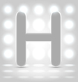 H over lighted background