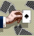 hand with the ace of spades playing card vintage vector image vector image