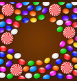 colored candies sweets and lollipops on a brown vector image