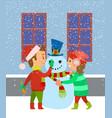 children building snowman kids having fun winter vector image