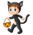 little girl in cat costume with pumpkin basket vector image vector image